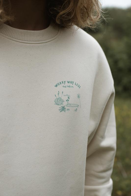 Close Up Of Crewneck Of Organic Cotton With Screenprint Design Of Isabelle Vandeplassche Designer On The Front Chest