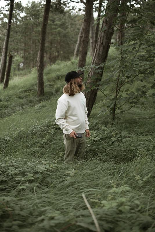 Boy Looking Up In The Sky In The Woods Wearing Organic Clothing Of Inmind Clothing X Isabelle Vandeplassche